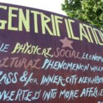 Hand made sign about gentrification in a demonstration.