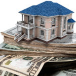 Symbolic picture of home built on money stacks